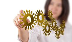 Stock Illustration of gold people cogs as concept