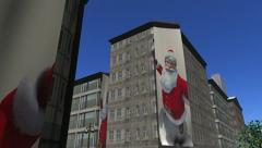 Banners of Santa Claus unfurl down buildings - stock footage