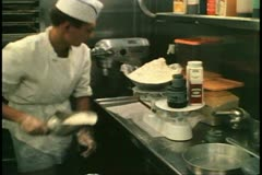 Cruise ship galley, kitchen, MV Horizon, Atlantic Ocean, scooping sugar Stock Footage
