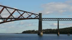 Train crossing Forth Rail Bridge Scotland Stock Footage