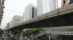 Train on skyrail in downtown Bangkok Stock Footage