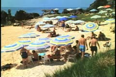 Umbrellas and swimmers on beach, Tobacco Bay, Bermuda Stock Footage