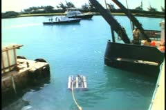 Marine Biological Station, Bermuda, searching device floating atop sea Stock Footage