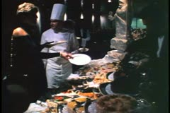 Midnight buffet on a cruise ship, crowd very dressy, tuxedos, formal Stock Footage