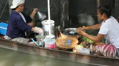 Floating market Thailand women cooking Stock Footage