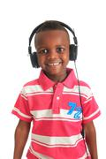 african american black child listening to music isolated - stock photo