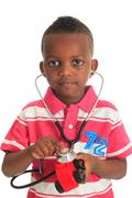 Black african american child with stethoscope and car Stock Photos