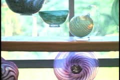 Glassblowing Studio in Bermuda, finished goods, art glass bowl Stock Footage