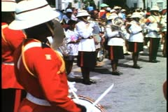 Bermuda Regimental Marching Band, red white uniforms, all black men - stock footage