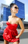 independent brunette in sunglasses on street - stock photo