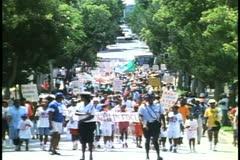 Labor Day parade in Hamilton, Bermuda, signs advocating labor rights - stock footage