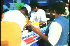 Snow cone stand, yellow snow cone, Labor Day in Hamilton, Bermuda Stock Footage