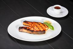 Grilled salmon on the white plate Stock Photos