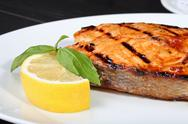 Stock Photo of Grilled salmon on the white plate