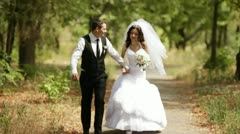 Bride and groom walking Stock Footage