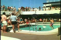 Cruise ship deck pool party mayhem, two guys on pole in pool Stock Footage
