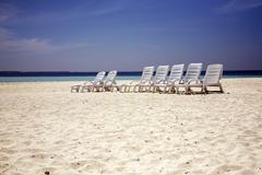 Beach loungers Stock Photos