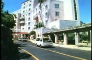 Castle Harbor Hotel in Bermuda, old section tilt up, cars in front 1993 Stock Footage