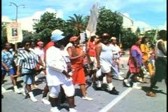 Labor Day parade in Hamilton, Bermuda, signs, passing City Hall Stock Footage