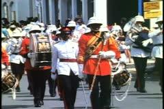 Bermuda Regimental Marching Band,  marching forward down street Stock Footage