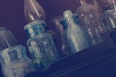 Glass Bottles on Hutch - stock photo