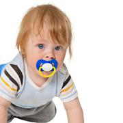 Attentive baby with a pacifier Stock Photos
