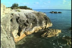 Stock Video Footage of Seacoast off St. George, Bermuda, craggy coastline, magic hour