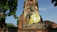 Sitting buddha at ancient temple in Thailand Stock Footage