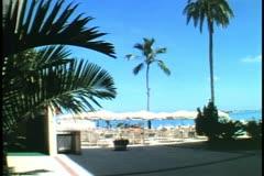 Castle Harbor Hotel in Bermuda, umbrellas, palms, no people Stock Footage