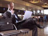 Businessman and airport Stock Photos