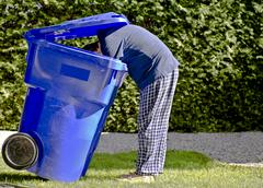 blue bin man. - stock photo