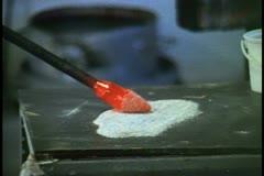 Glassblowing Studio in Bermuda, roll molten glass in beads, furnace Stock Footage