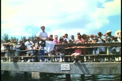 Stock Video Footage of Man talks to her and directs her to be dunked again, St. George, Bermuda