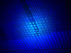 Abstract blue light over lamp heap surface, science Stock Photos