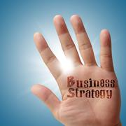 Stock Photo of business strategy on his hand