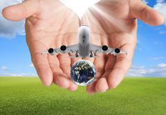 hand holds airbus plane and globe - stock illustration