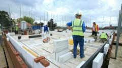 Bricklayers on Construction site (time-lapse). Stock Footage