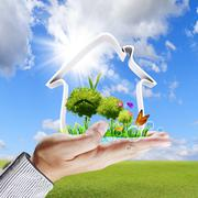 human hand shows a green house concept - stock illustration