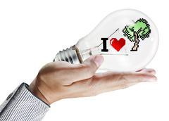light bulb in hand - stock illustration