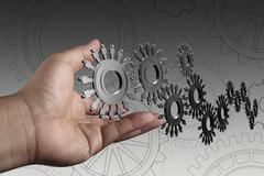 Stock Illustration of hand shows people cogs as concept
