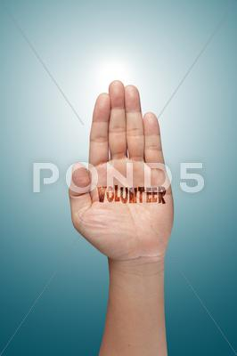 Stock photo of volunteer raising hand