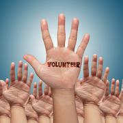 Stock Photo of volunteer group raising hands
