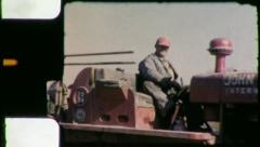 Man Drives CONSTRUCTION Machinery Earthmovers 1950s Vintage Film Home Movie 4648 Stock Footage