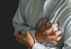 Businessman has heart attack Stock Illustration