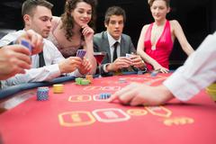 People playing exciting game of poker - stock photo