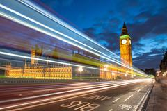 nocturne scene with big ben and house of parliament behind light beams - lond - stock photo