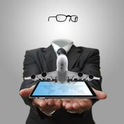 Invisible business man shows tablet computer with aircraft as concept Stock Illustration
