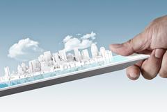 Stock Illustration of city on touch screen tablet as concept