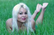 Stock Photo of sexy blonde lying in a grassy field (3)