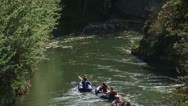 Stock Video Footage of Groups of rafters following each another .